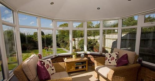 A solid conservatory roof can be a cosy space away from the weather